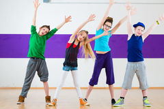 Kids train Zumba fitness in dancing school Royalty Free Stock Photos