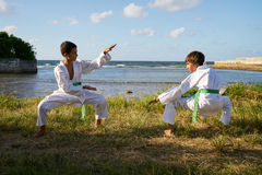 Kids Training At Karate School For Sport Activity Leisure Fun. Children doing combat and extreme sports. Latino boys exercising in karate and traditional martial Royalty Free Stock Images