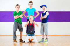 Kids training Zumba fitness in dancing school Royalty Free Stock Photo