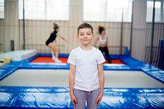 Kids in trampoline center. A portrait of happy kids in trampoline center stock photography
