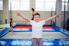 Kids in trampoline center. A portrait of happy kids in trampoline center stock photo