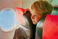 Kids travel- cute little boy in plane. Kids travel concept- cute little boy in plane Stock Photo