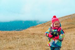 Kids travel- little girl hiking in winter mountains. Kids travel- cute little girl hiking in winter mountains Royalty Free Stock Image