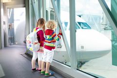 Kids travel and fly. Child at airplane in airport Royalty Free Stock Image