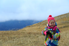 Kids travel- little girl hiking in winter mountains Stock Photo