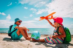 Free Kids Travel On Beach, Boy And Girl With Globe And Toy Plane Stock Photography - 161361632