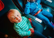 Kids travel by plane, family in flight. Cute little girl in plane stock images