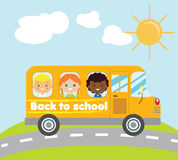 Kids traveling in yellow school bus. Back to school theme Stock Image
