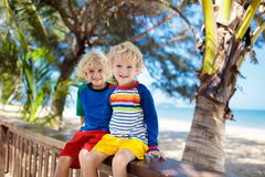 Kids at tropical beach. Child on summer vacation stock photo