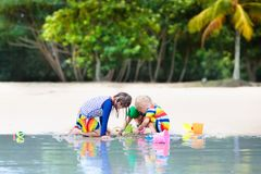 Kids on tropical beach. Children playing at sea. Stock Images
