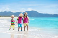 Kids on tropical beach. Children playing at sea. Royalty Free Stock Image
