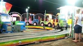 Kids on truck ride in amusement park stock video