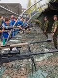 Kids trying rifles on army day Royalty Free Stock Photo