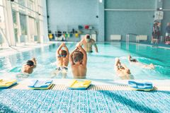 Kids trying to dive in swimming pool. Like a trainer. Instructor shows an exercise how to dive. Healthy sports activity in pool. Sportive kids activity in Stock Photo