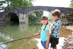 Kids trying to fish on sunny day Stock Images