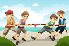 Kids in tug of war. A vector illustration of cute boys playing tug of war Royalty Free Stock Images