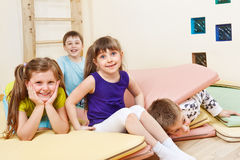 Kids on tumbling mats Stock Photo