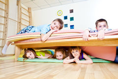 Kids on tumbling mats. Kids group lying on tumbling mats Stock Images