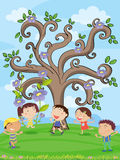 Kids under a tree Stock Image