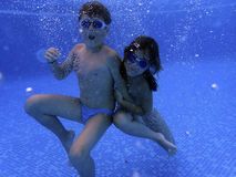 Kids underwater in the pool Royalty Free Stock Photos