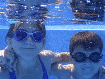 Kids underwater in the pool Royalty Free Stock Image