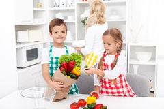 Kids unpacking groceries in the kitchen Royalty Free Stock Image