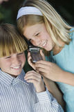 Kids Using Cellphone Together Royalty Free Stock Images