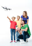 Kids using flying hexacopter drone. Happy kids using flying hexacopter drone isolated on white royalty free stock photos