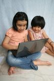 Kids using laptop Royalty Free Stock Images