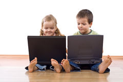 Kids using laptop computers stock photography