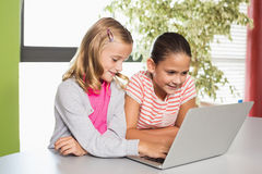 Kids using laptop in library Stock Image