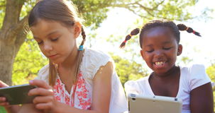 Kids using mobile phone and digital tablet stock video footage