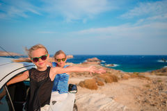 Kids on vacation travel by car. Summer holiday and car travel concept Stock Photography