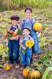 Kids with vegetables on field Stock Photography