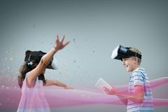 Kids in VR headset playing against grey background with pink lights. Digital composite of Kids in VR headset playing against grey background with pink lights Royalty Free Stock Image