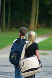 Kids Waiting on Bus. Boy and girl waiting to catch bus Stock Photography