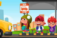 Kids Waiting at a Bus Stop Stock Images