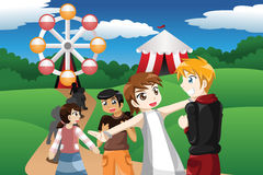 Kids waiting in line in an amusement park. A vector illustration of kids waiting in line before going to a ride ferris wheel in an amusement park Stock Image