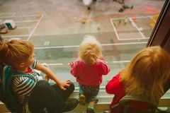 Kids waiting for plane in airport, family travel. Concept royalty free stock image