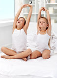Kids waking up and stretching Royalty Free Stock Photography