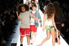 Kids walk the runway finale during Rookie USA Presents Kids Rock! Fall 2016. NEW YORK, NY - FEBRUARY 11: Kids walk the runway finale during Rookie USA Presents Stock Image