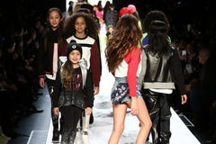 Kids walk the runway finale during Rookie USA Presents Kids Rock! Fall 2016. NEW YORK, NY - FEBRUARY 11: Kids walk the runway finale during Rookie USA Presents Royalty Free Stock Photos
