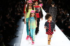 Kids walk the runway finale during Rookie USA Presents Kids Rock! Fall 2016. NEW YORK, NY - FEBRUARY 11: Kids walk the runway finale during Rookie USA Presents Stock Photos