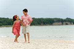 Kids walking on the beach Royalty Free Stock Photo