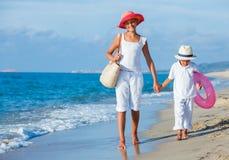 Kids walking at the beach Royalty Free Stock Image