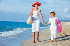 Kids walking at the beach Stock Image