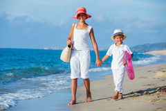 Kids walking at the beach Stock Images
