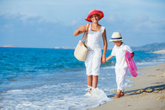Kids walking at the beach Royalty Free Stock Images