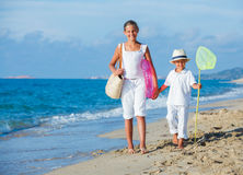 Kids walking at the beach Stock Photography