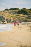 Kids walking on the beach Royalty Free Stock Images